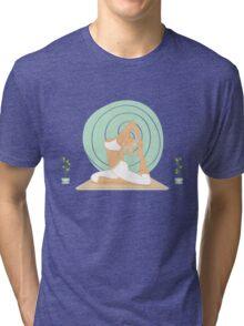 Beautiful woman doing yoga practice Tri-blend T-Shirt