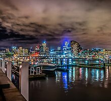 Docklands At Night by Russell Charters