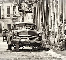 Man Repairing His Car in Havana by Witold Skrzypiński