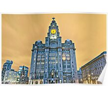 Liver building with orange sky Poster