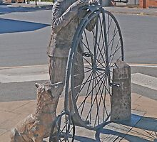 The Pennyfarthing cyclist and his dog  by Margaret  Hyde
