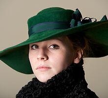 Redhead serious in green hat and black coat by Nick Dale
