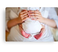 Baby in the Arms Canvas Print