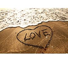 Love concept handwritten on sand Photographic Print