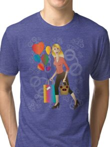 Beautiful blond woman with gift and balloons.  Tri-blend T-Shirt