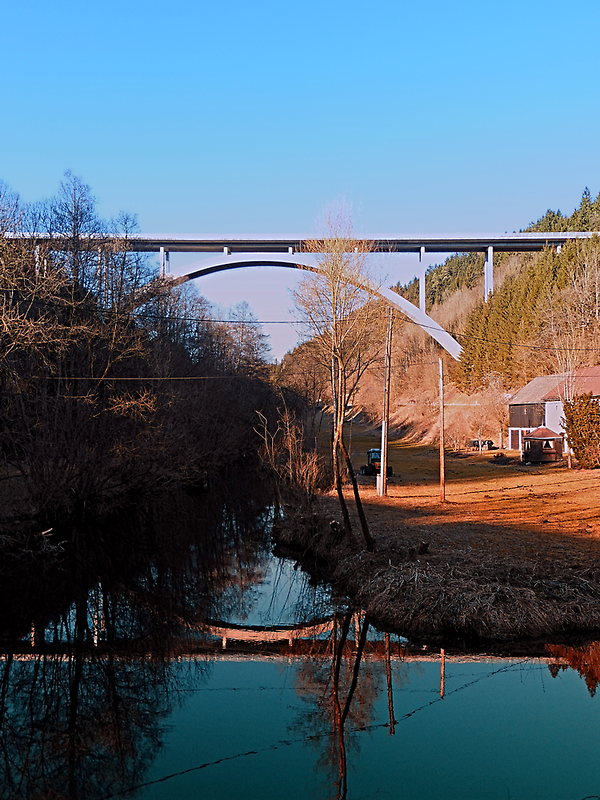 A bridge, the valley and beautiful reflections | architectural photography by Patrick Jobst