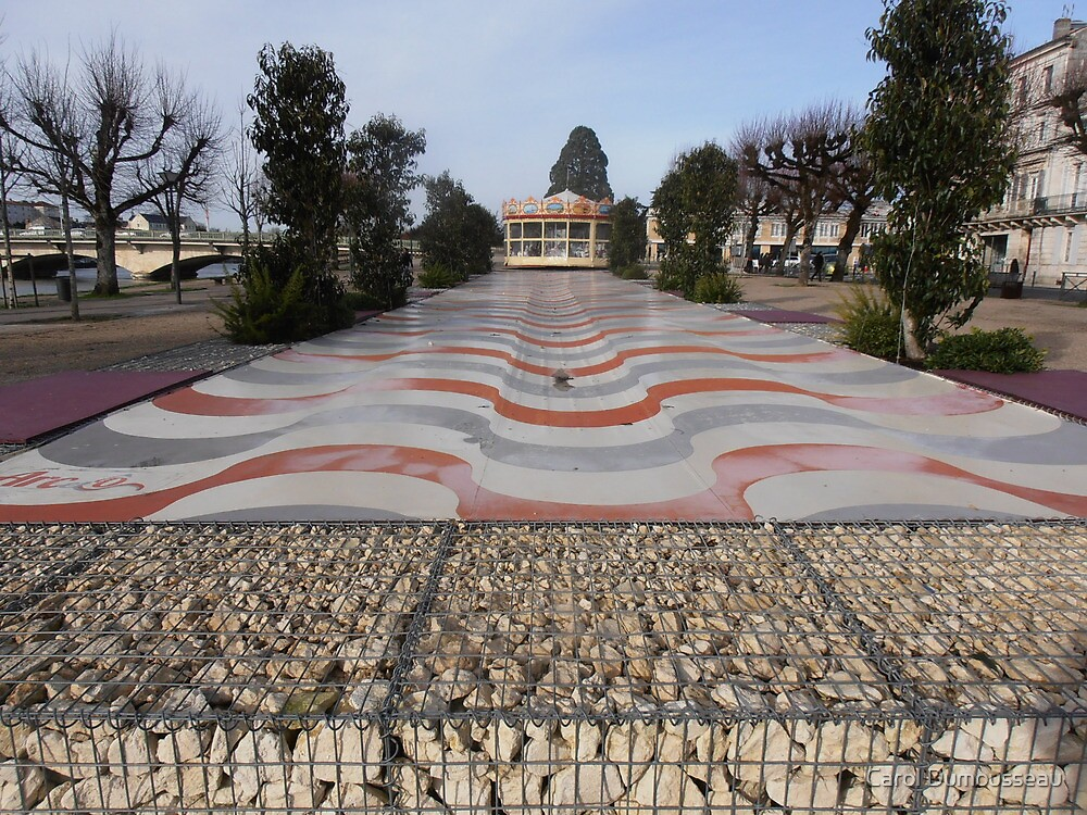 Curvy pavement and a roundabout by Carol Dumousseau
