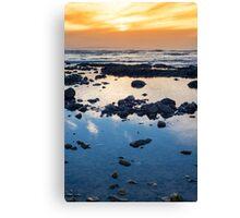 beautiful mellow sunset over rocky beach Canvas Print