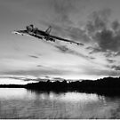 Vulcan low over a sunset lake B&W version by Gary Eason