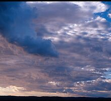 blue clouds in sunset  by damil