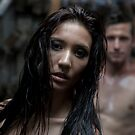 Semi naked couple in an industrial workshop by Ben Ryan