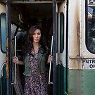 Woman standing in the doorway of a derelict bus by Ben Ryan