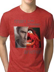 MAN is the cruelest ANIMAL Tri-blend T-Shirt
