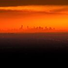 Red City Sunset by Raymond J. Marcon