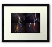 Paint brushes in water Framed Print