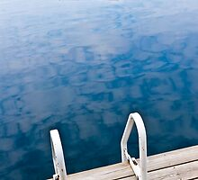 Dock on calm lake in cottage country by Elena Elisseeva