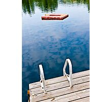 Dock on calm lake in cottage country Photographic Print