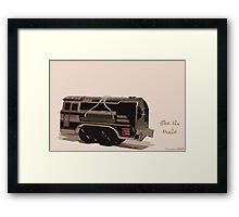 The tin train. Framed Print