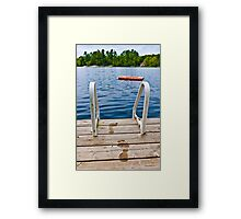 Footprints on dock at summer lake Framed Print