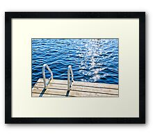 Dock on summer lake with sparkling water Framed Print