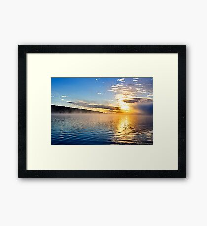 Sunrise on foggy lake Framed Print