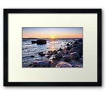 Sunset over water Framed Print