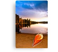 Lake sunset with canoe on beach Canvas Print