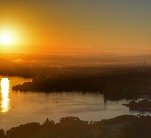 Sunrise over Canberra by Candy Jubb