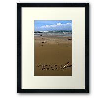 written in the sand on a  beach with feather quill Framed Print