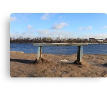 An empty Bench by the river Canvas Print