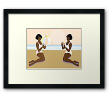 Having a ball at the beach Framed Print