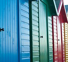 Colourful beach huts by photoeverywhere