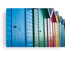 Colourful beach huts Canvas Print