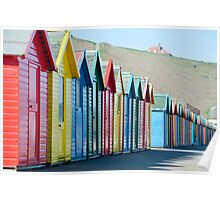 Row of colourful Beach huts Poster