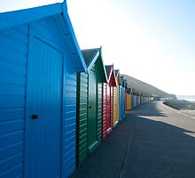 Brightly coloured beach huts, Whitby West Cliff by photoeverywhere