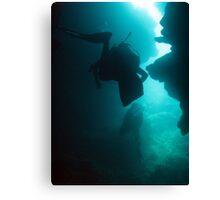 Scuba divers cave diving Canvas Print
