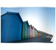 Row of brightly coloured beach huts Poster