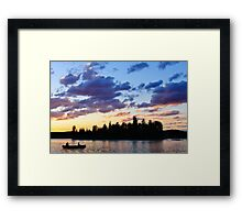 Canoeing at sunset Framed Print