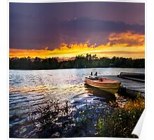 Boat docked on lake at sunset Poster