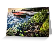 Rowboat at lake shore at dusk Greeting Card