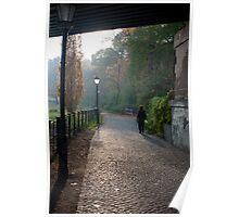 Woman walking on a misty footpath Poster