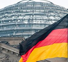 German flag and the Reichstag dome by photoeverywhere