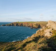 Lizard Point and the Lizard lighthouse by photoeverywhere