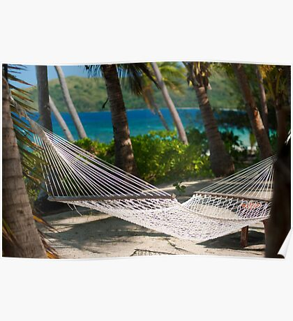 Empty hammock strung from palm trees Poster
