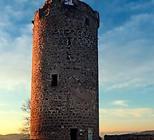 The tower of Waxenberg castle in the sunset | architectural photography by Patrick Jobst