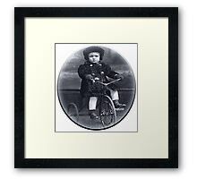 The girl with the tricycle Framed Print