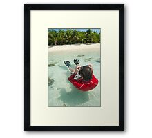 Man snorkeling in shallow water Framed Print