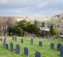 Gravestones in the churchyard at Hawkshead by photoeverywhere