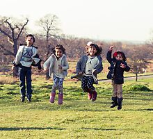 Group of kids jumping by Waqas-Aftab