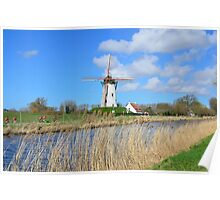 Bikers passing by an old windmill in Damme, Flanders Poster